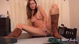 British dominatrix Lara Latex masturbating insusceptible to table top beside sexy leather boots