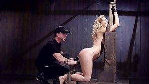 Blindfolded blonde is toyed in bondage