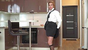 Bossy Russian woman Oliya is masturbating pussy in the kitchen