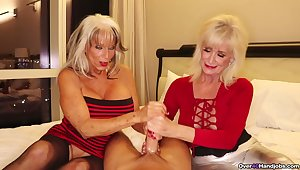 Mature sluts with fake tits pleasuring one lucky scrounger together