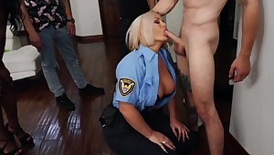 Choke-full blonde cop Julie Cash sexes forth a hung younger person