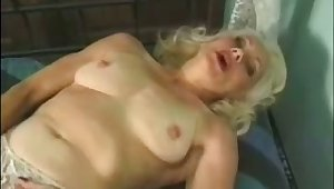 Mature auburn termagant masturbates her soiled old pussy with a toy
