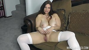 Curvy beauty stands vacant and masturbates