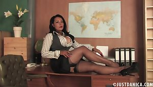 Foxy mature Danica Collins moans while fingering her wet have sexual intercourse hole