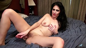 Theresa Soza enervating black lace underwear playing with a vibrator